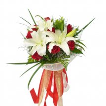 White liliums and Red Roses in Vase