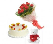 Pineapple Cake half kg with 8 red roses and 6 inches Teddy