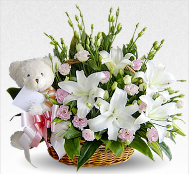 White Teddy Bear with white flowers basket