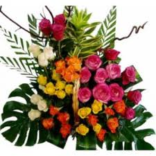 24 Gerberas and Roses with Palm leaves in Basket