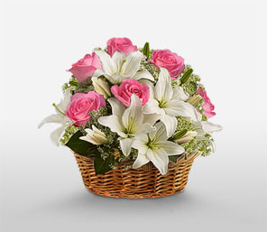 Pink roses with white lilies basket