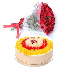 12 red roses bouquet with 1/2 Kg Fresh fruit cake