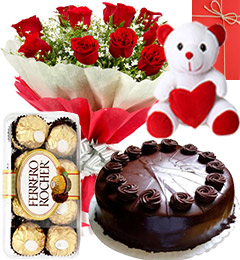 8 Red Roses bouquet with Teddy 1/2 kg chocolate cake and 16 Ferrero chocolates