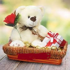 Teddy bear(6 inches) with 1 red rose and 2 dairy milk chocolate bars in same basket
