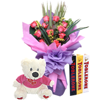 3 Toblerone chocolates+Teddy+12 Pink roses bouquet