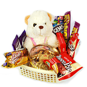 Teddy in basket of chocolates(ChocoPie Gems Dairy Milk 5Star etc)