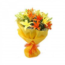 Yellow and orange Lilies bouquet with yellow wrapping paper