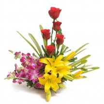 6 Red roses 2 Yellow lilies 6 purple orchids basket