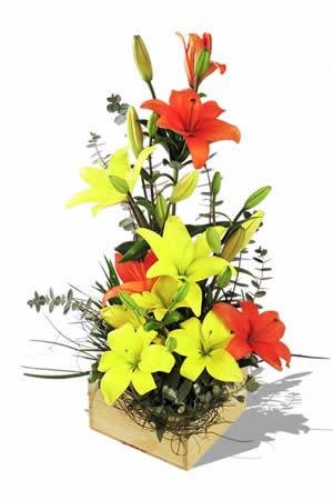 Yellow and orange lilies in basket