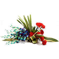 6 Blue orchids with 6 Red canations in a Basket